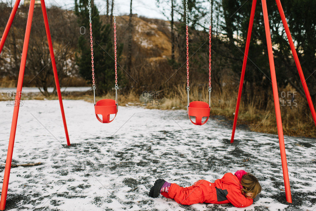 Girl after falling at the playground in winter