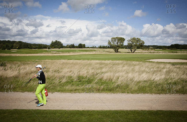 Copenhagen, Denmark - August 10, 2011:  Thorbjørn Olesen walking on a golf course