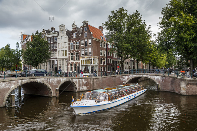Amsterdam, Netherlands - September 5, 2012: Tour boat on the Leidsegracht Canal
