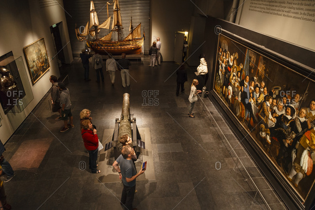 Amsterdam, Netherlands - September 5, 2012: People viewing art at the Rijksmuseum