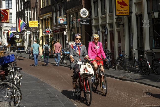 Amsterdam, Netherlands - September 8, 2012: Street scene in Oudezijds Kolk, street in Oude Zijde