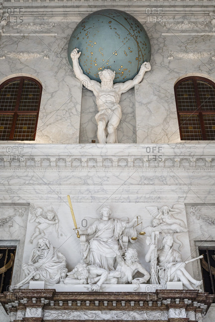 Amsterdam, Netherlands - September 7, 2012: Statue of Atlas at the entrance to the Magistrates Court in Citizens' hall in the Koninklijk Paleis, the Royal Palace