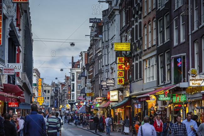 Amsterdam, Netherlands - September 7, 2012: Street scene on Damstraat