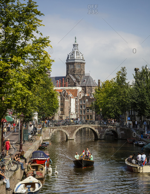 Amsterdam, Netherlands - September 6, 2012: View of Oudezijds Voorburgwal canal and Sint Nicolaaskerk, St. Nicholas church