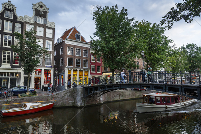 Amsterdam, Netherlands - September 10, 2012: Oudezijds Voorburg canal in the red light district, Amsterdam, Holland