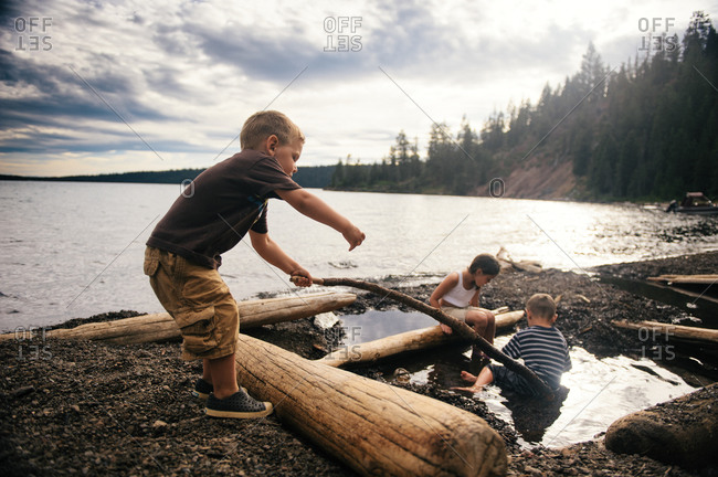 Children playing on a lake shore
