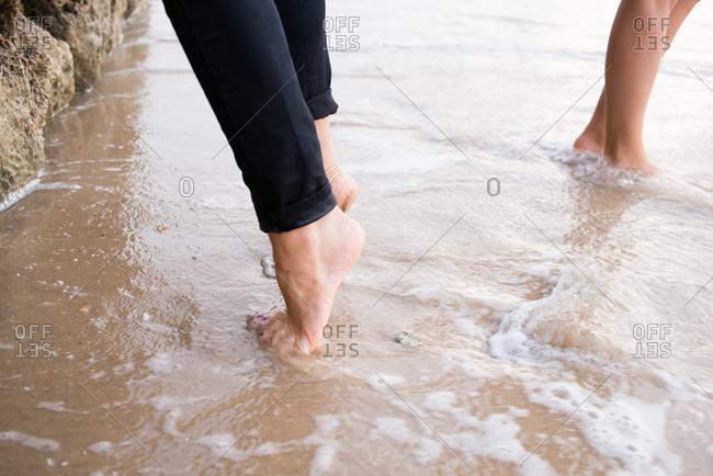Bare feet standing in the ocean