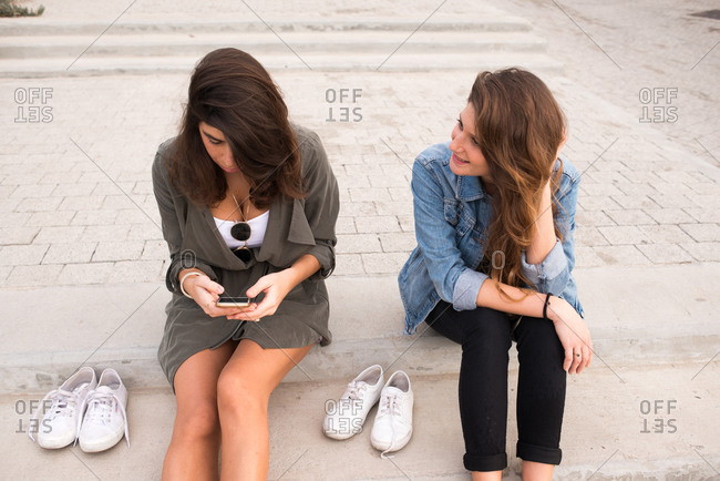 Young women sitting on steps