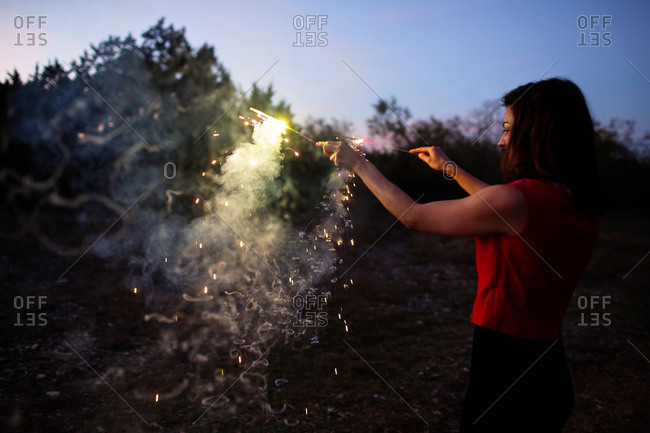 Woman playing with sparklers