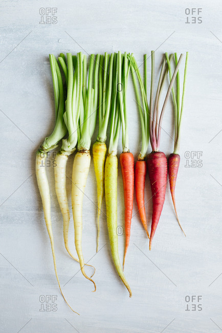 Arrangement of rainbow carrots on a light background
