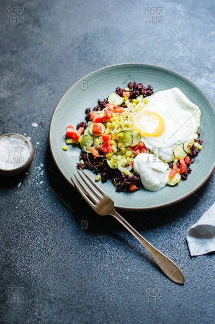 Vegetable saute and black rice with a fried egg on top