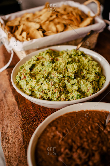 Chips with guacamole and refried beans