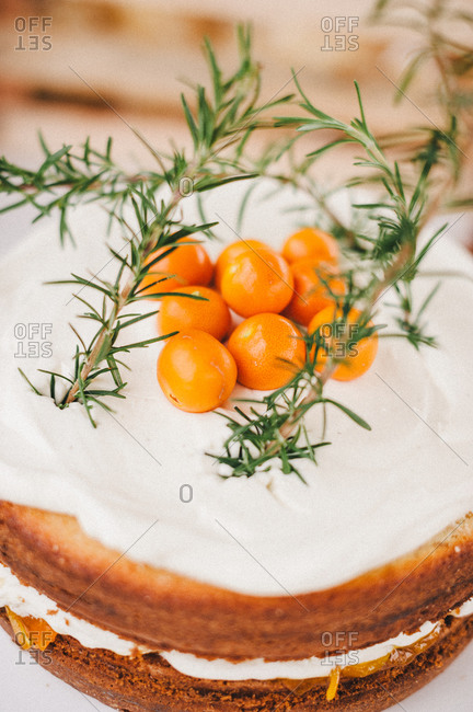 Cake topped with clementine and thyme