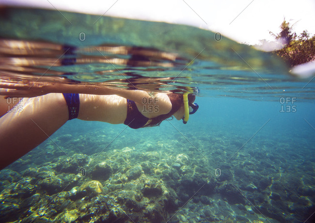 Woman snorkeling over a reef