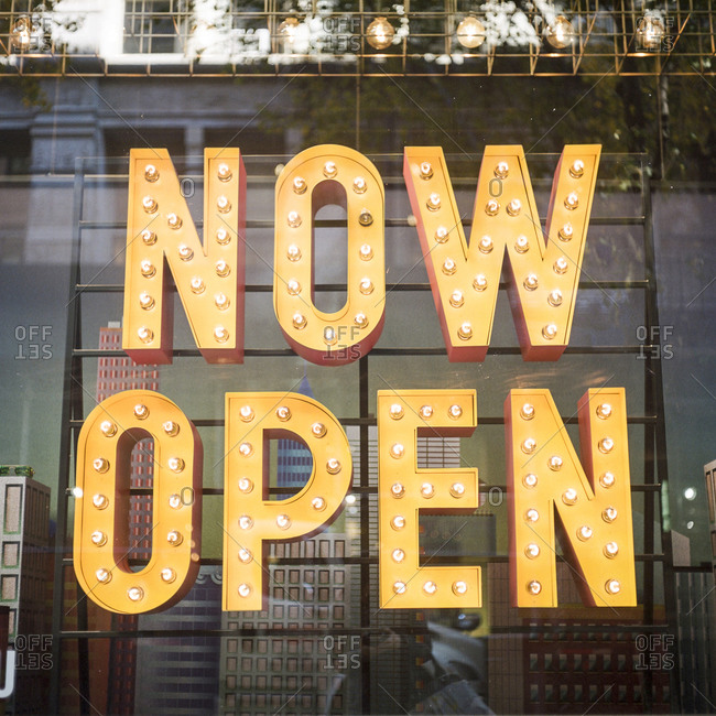 """""""Now Open"""" sign spelled with marquee letters"""