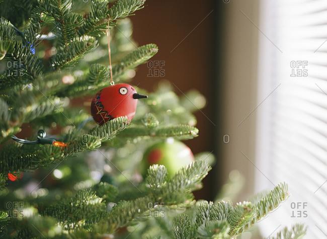 Whimsical bird ornament on a Christmas tree