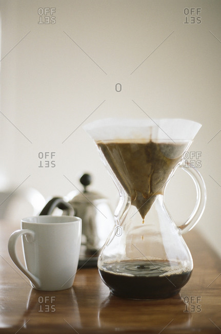 Coffee brewing in a glass pour over coffee maker
