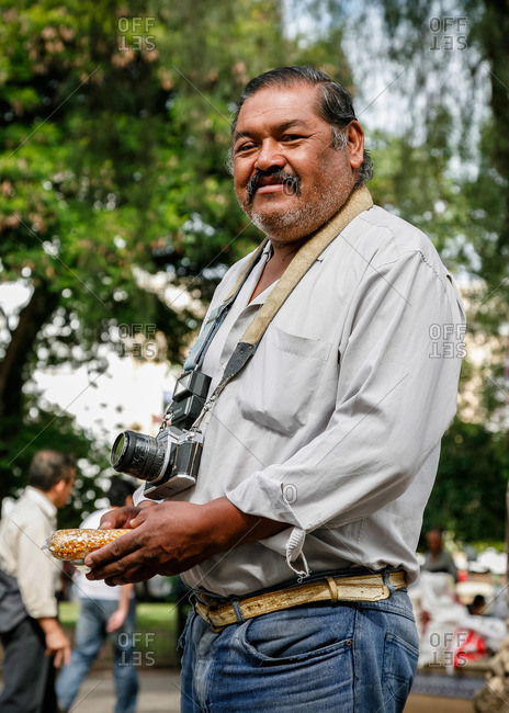 Salta, Argentina - January 5, 2012: Local photographer at Plaza 9 Julio, the main square