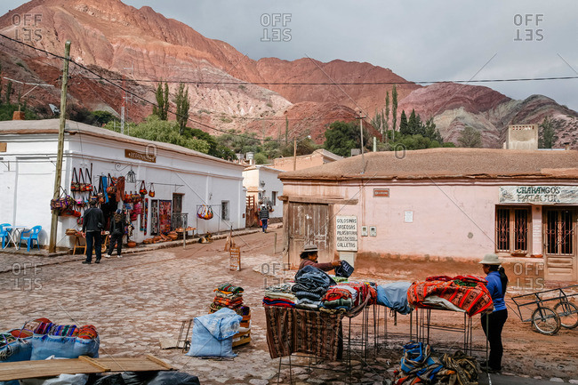 Purmamarca, Quebrada de Humahuaca, Jujuy Province, Argentina - January 7, 2012: Market scene and the mountain of seven colors