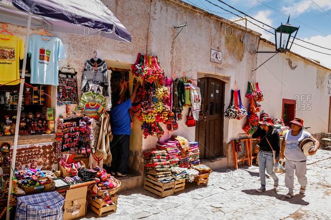 Humahuaca, Quebrada de Humahuaca, Jujuy Province, Argentina - January 8, 2012: Shop and pedestrians