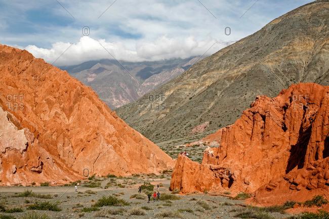 Tourists at the Camino de los Colorados trail around Purmamarca, Quebrada de Humahuaca, Jujuy Province, Argentina