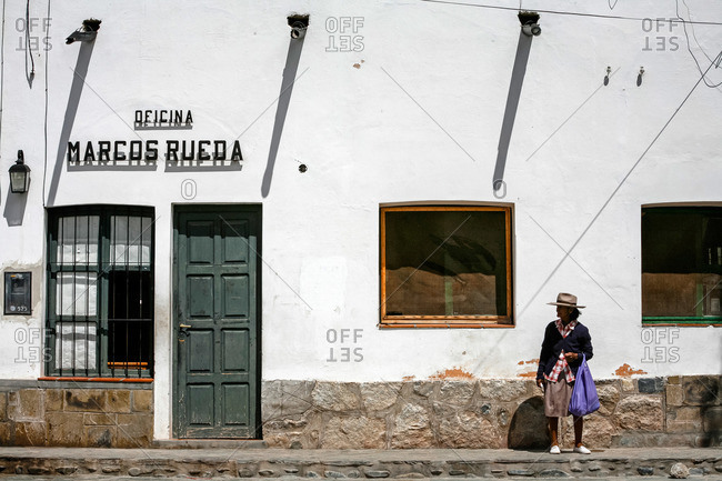 Cachi, Salta Province, Argentina - January 4, 2012: Woman standing on sidewalk