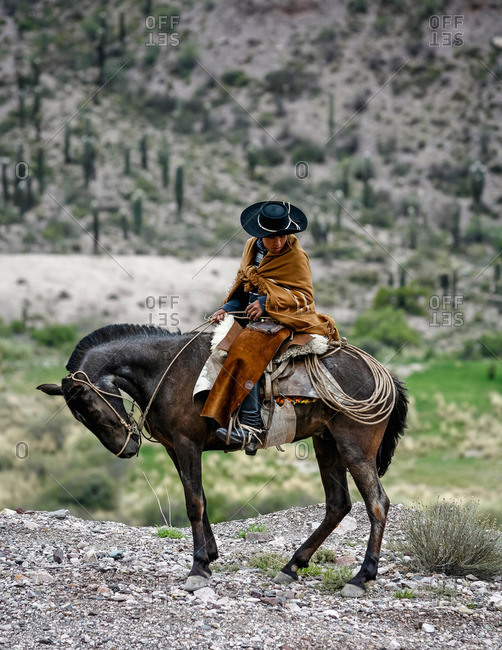 Quebrada de Humahuaca, Jujuy province, Argentina - January 6, 2012: Northern gaucho on a horse near Purmamarca
