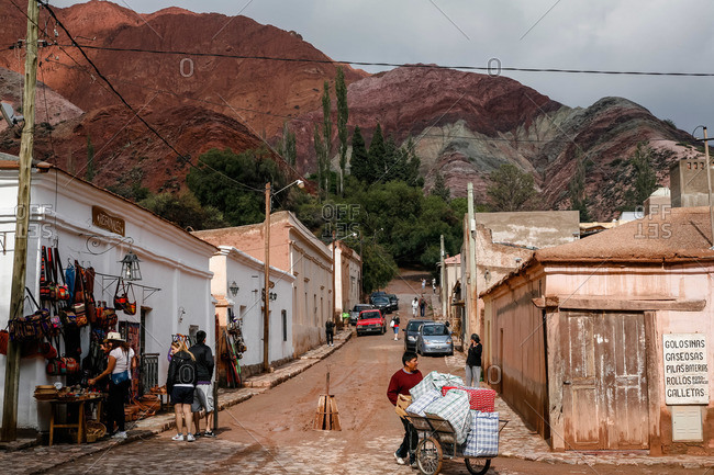 Purmamarca, Quebrada de Humahuaca, Jujuy Province, Argentina - January 7, 2012: Street scene and the mountain of seven colors