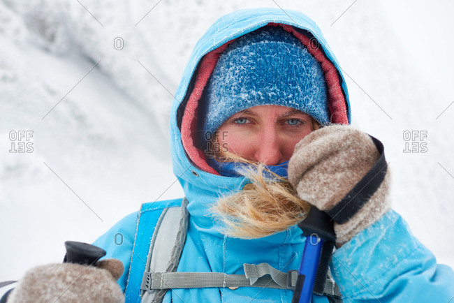 Portrait of a woman hiking in snowy weather