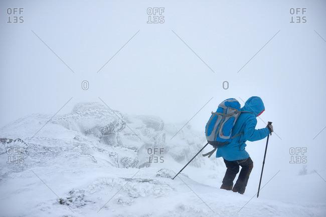 Hiker walking in winter