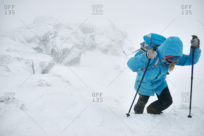 Woman hiking in snowy weather