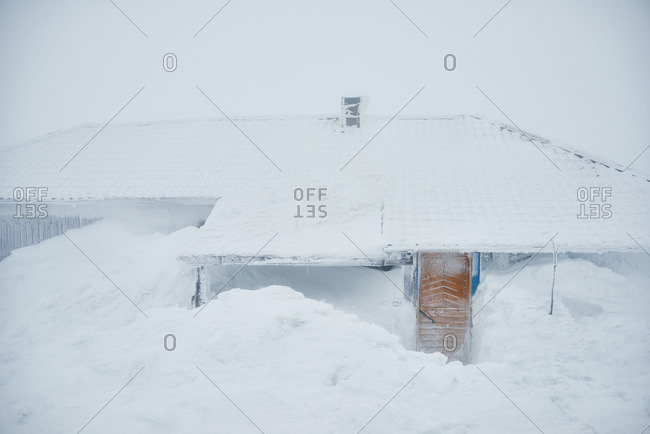 Winter house covered in snow