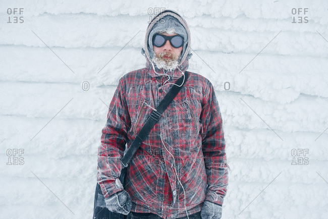 Portrait of a bearded man in goggles and winter wear
