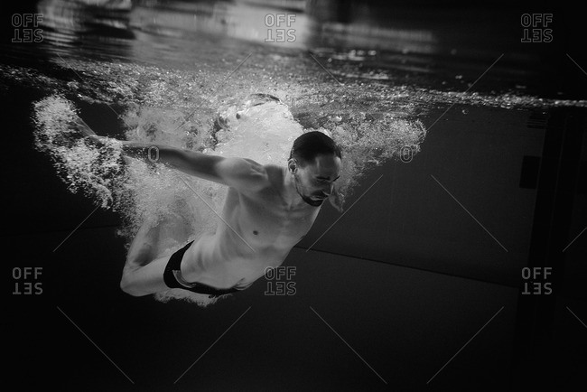 Man entering water with a jump