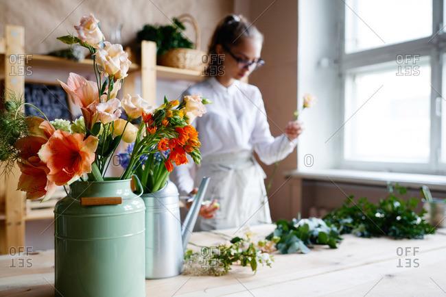 Florist creating floral arrangements - Offset