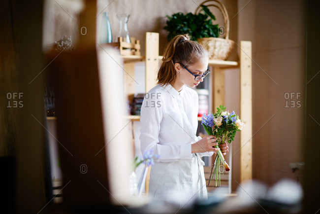 Woman arranging a bouquet in a flower shop