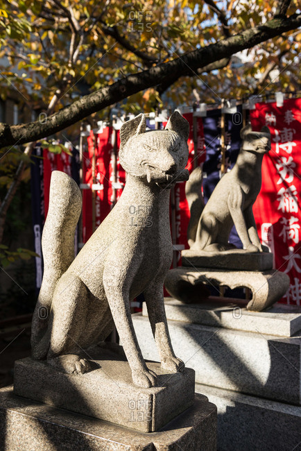 Osaka, Japan, December 2, 2015: Religious fox statues in Japan