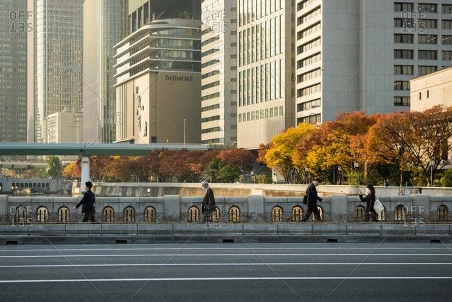 Osaka-shi, Osaka-fu, Japan - December 2, 2015: Bridge and pedestrians, Osaka, Japan