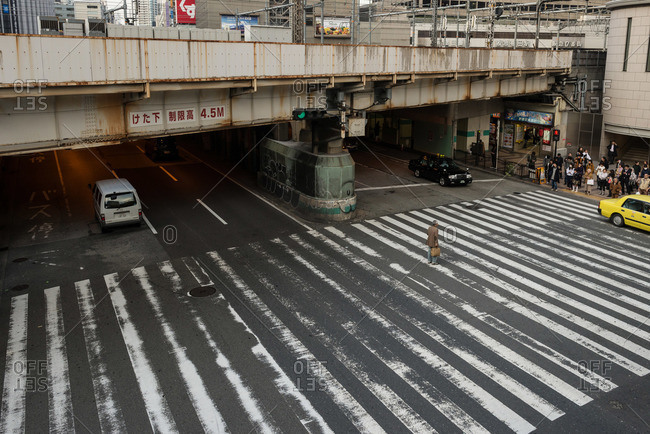 Osaka-shi, Osaka-fu, Japan - December 2, 2015: Man in middle of crosswalk, Osaka, Japan