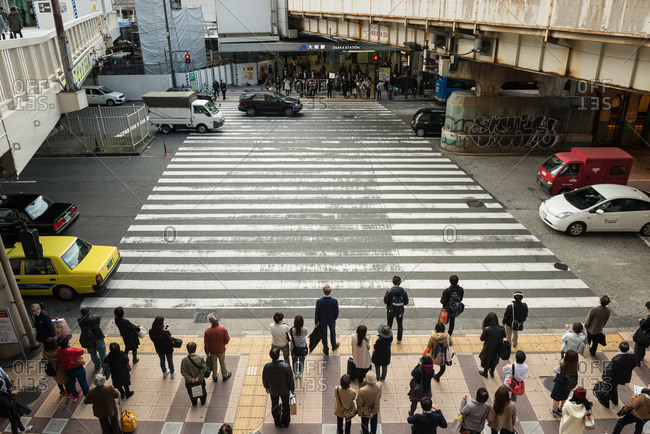 Osaka-shi, Osaka-fu, Japan - December 2, 2015: Crowd waiting to cross street, Osaka, Japan