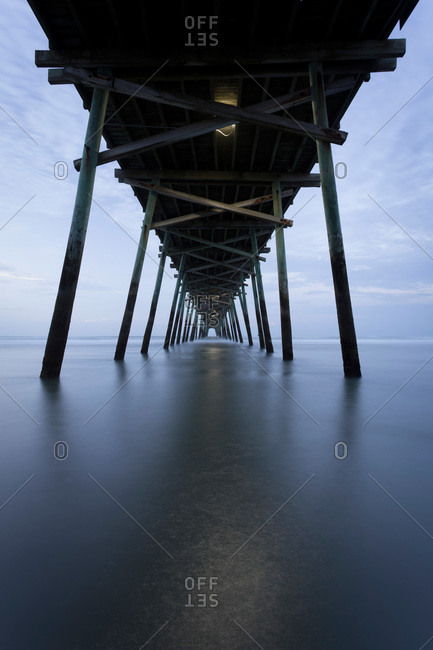 Underside of an ocean pier at dusk, Emerald Isle, NC