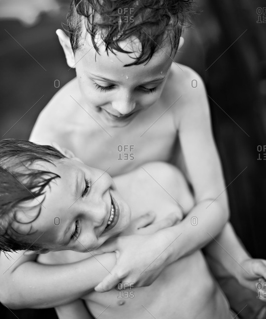 Brothers hugging and smiling
