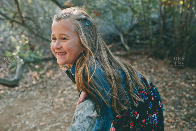 Little girl in a floral dress smiling