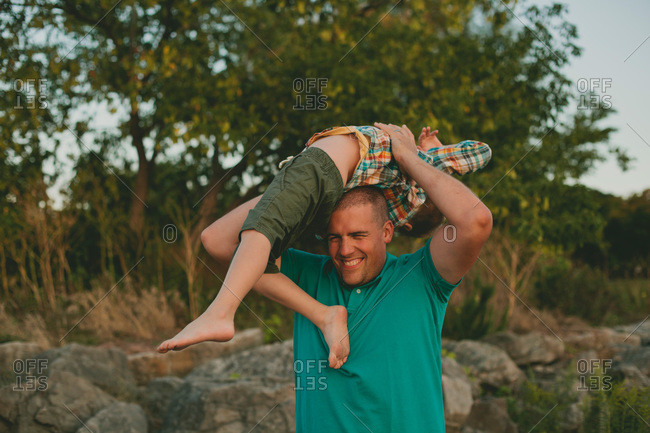 Man carrying his son playful on his head