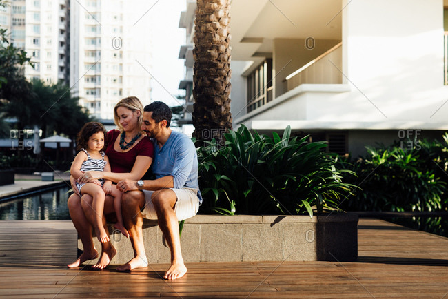 Family sitting on apartment deck