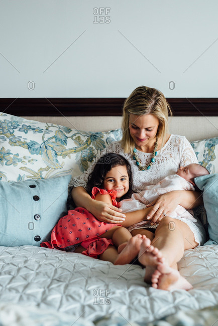 Mom with kids on bed