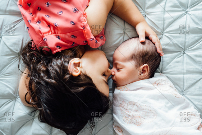 Girl nose to nose with baby