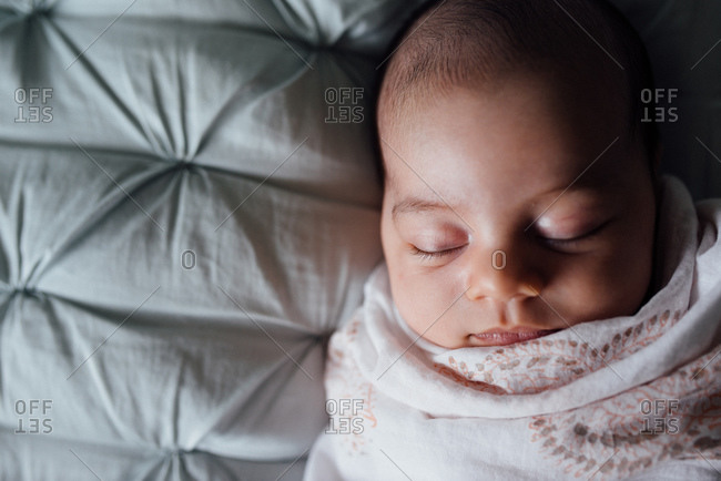 Baby asleep wrapped in blanket