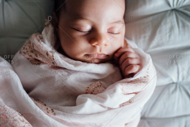 Baby asleep bundled in blanket