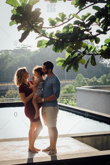 Couple holding girl on terrace